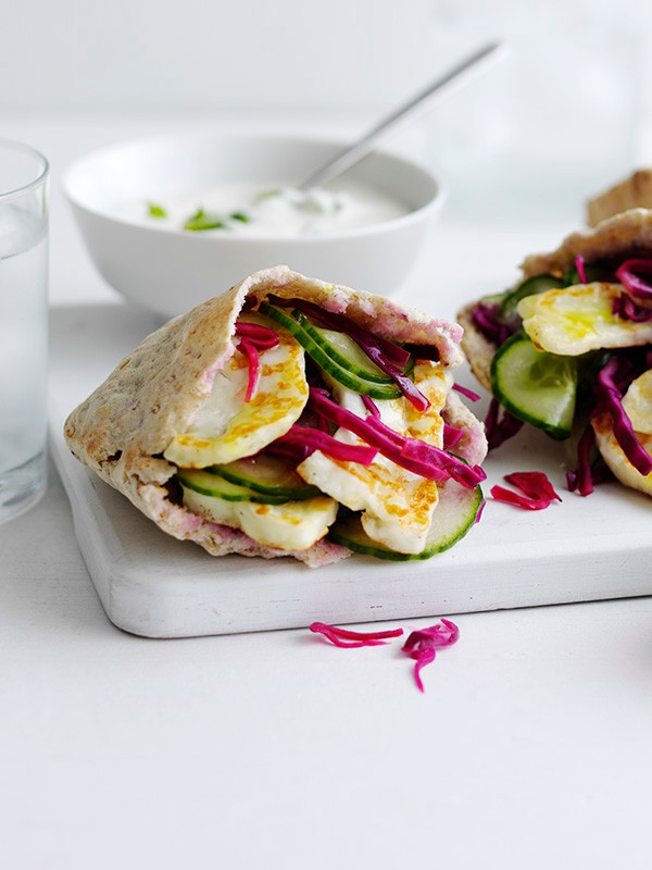 Halloumi-stuffed pittas with cucumber and pickled cabbage