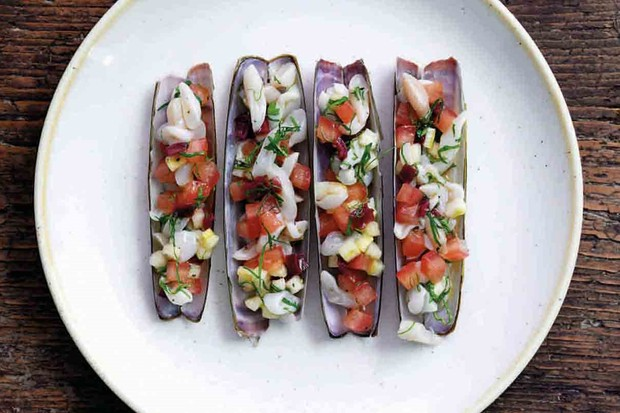 A white plate topped with razor clam ceviche