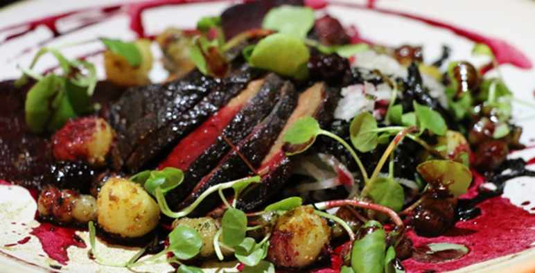 A plate of seared venison with pea shoots at Benedicts, Norwich