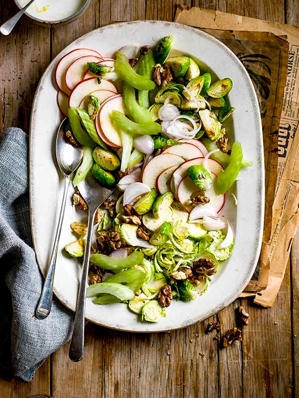 Waldorf Salad Recipe with Brussels Sprouts served on a oval white serving dish