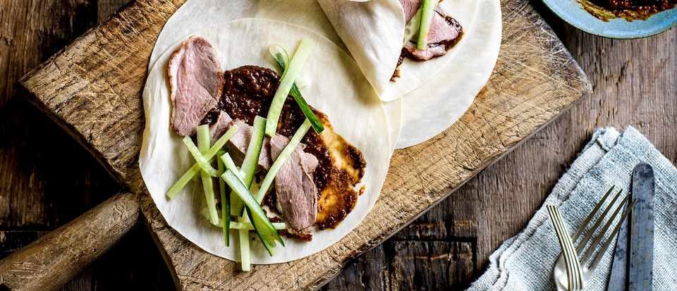 Duck with mole sauce and Peking-syle pancakes