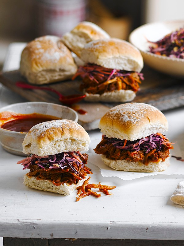 Soft white rolls filled with dark brown pulled pork