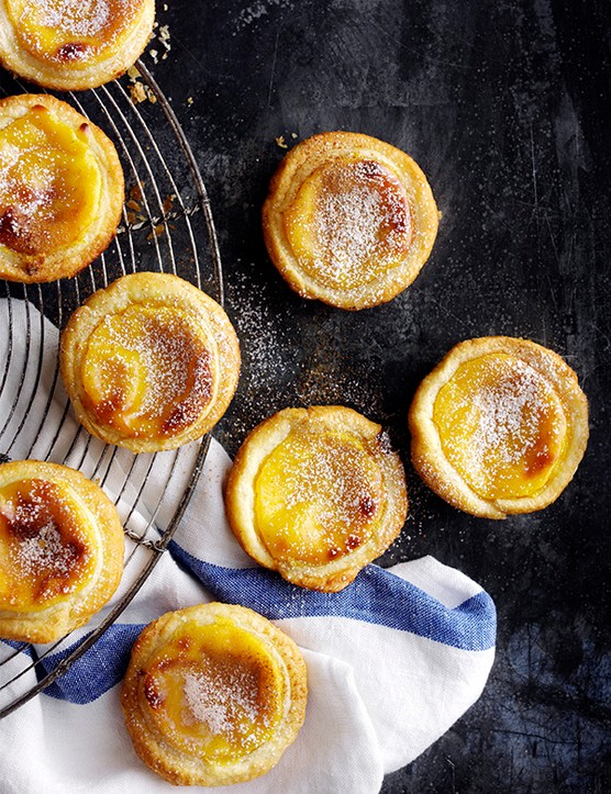 Portuguese custard tarts on a cooling rack