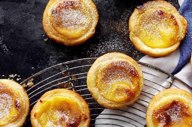 Portuguese custard tarts on a cooling rach