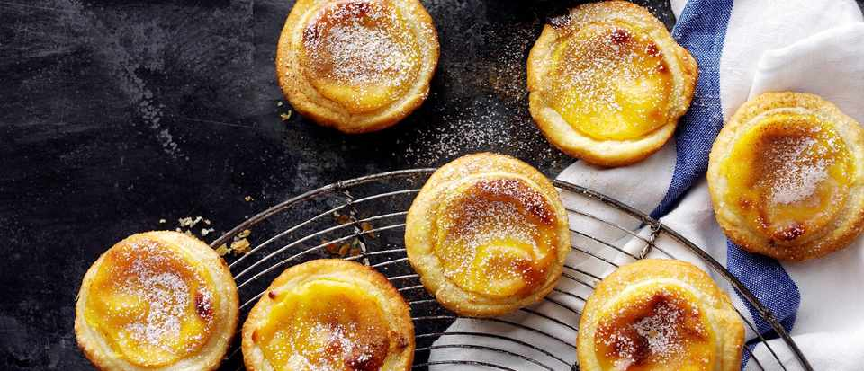 Portuguese custard tarts on a cooling rach