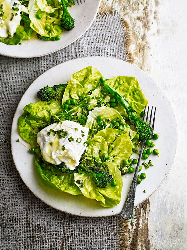 Spring Salad Recipe with Broccoli, Peas and Mozzarella served on a white plate and a white surface