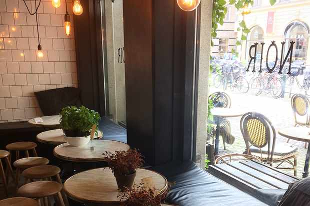 Tables and stools at Noir Coffee Shop Malmö Sweden
