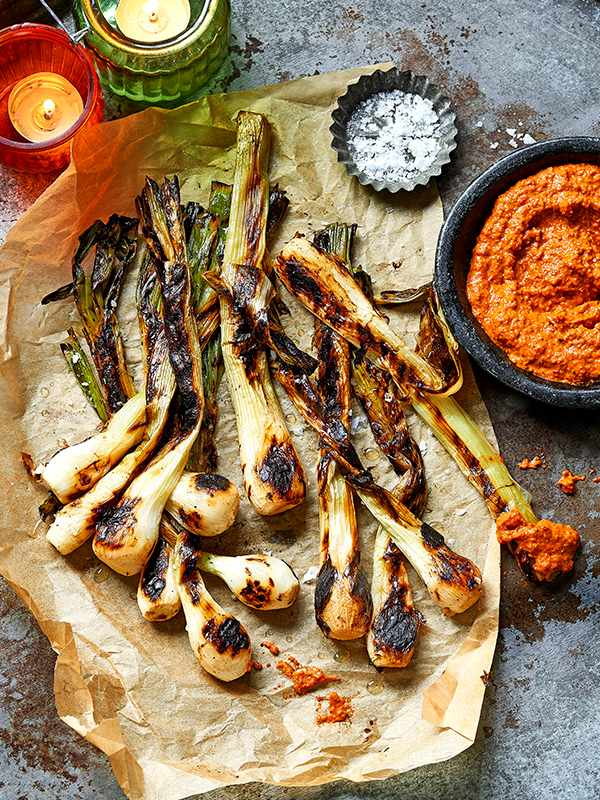 Tender spring onions with charred romesco