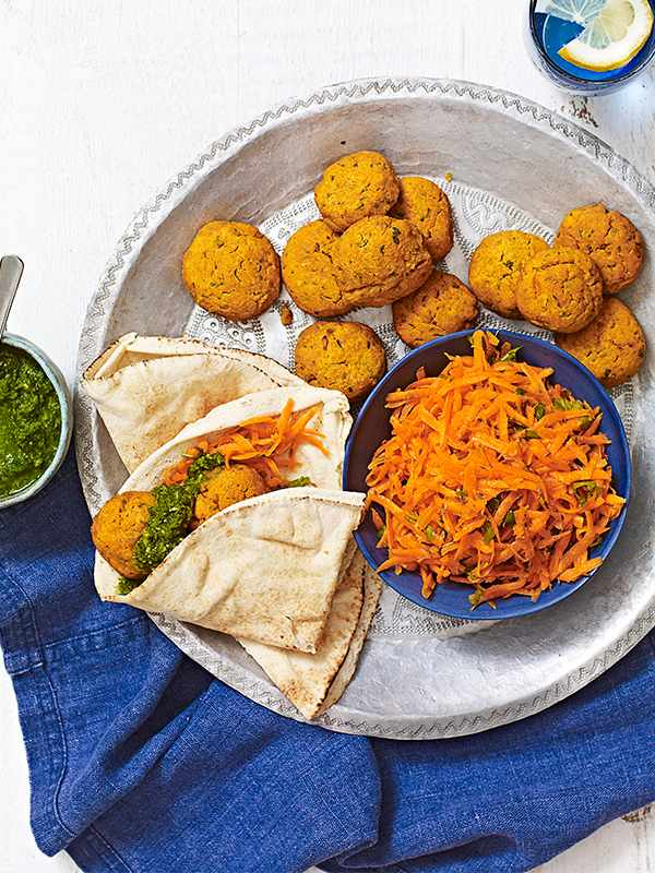 Sweet Potato Falafel Recipe With Coriander Chutney and Carrot Salad served with flatbread on a silver tray