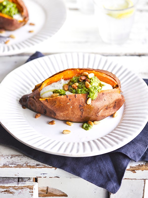 Baked sweet potatoes with pine nuts, tahini and pesto