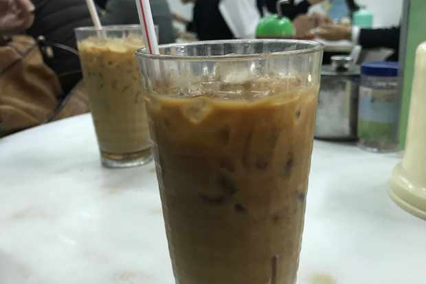 Milk tea using condensed milk served in a glass