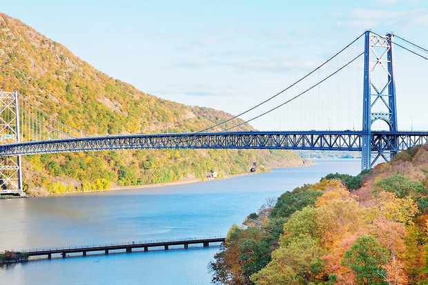Glistening blue Hudson Valley river with the bridge running over it in New York State