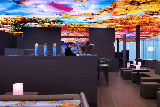 A rooftop bar with multicoloured ceiling