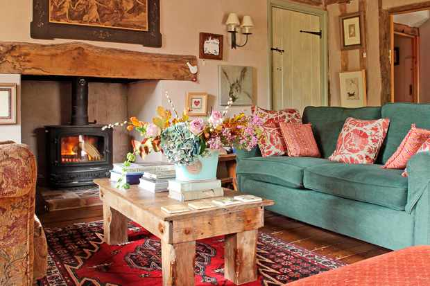 Wyken Vineyards, Suffolk with an open fire, turquoise sofa and wooden coffee table