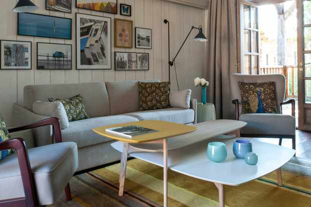 Les Sources de Caudalie living room with scandi furniture and art on walls
