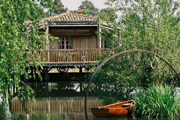 A riverside cabin room at Les Sources de Caudalie