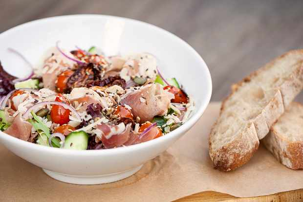 Salad bowl with bread at Saucisse Cape Town