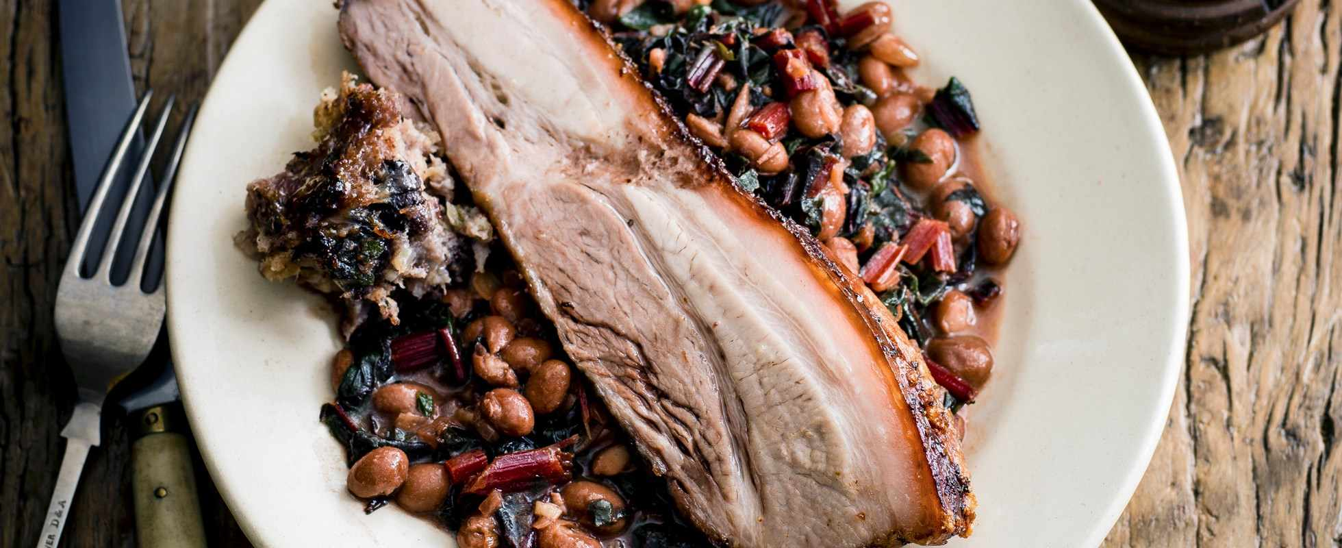 pork belly and quince with sage and black pudding stuffing and borlotti bean ragout