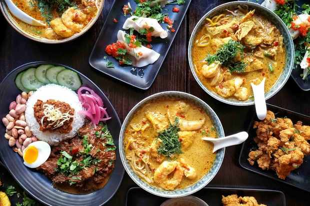 A spread of laksa bowls and Malaysian dishes at Sambal Shiok Laksa Bar London