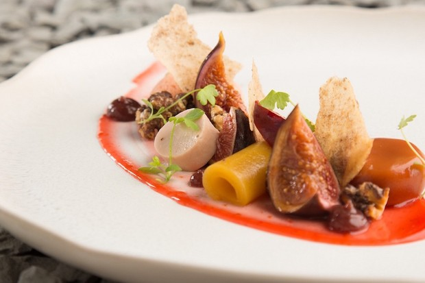 An elegant starter on a white plate at Peace & Loaf, Newcastle with figs and a red jus