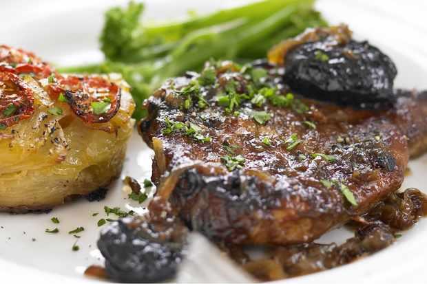 Braised pork chops with cider vinegar and prunes
