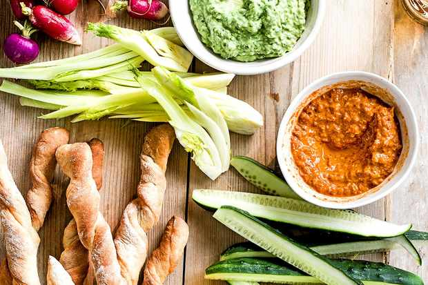 Green goddess and red devil dips with homemade breadsticks and veg