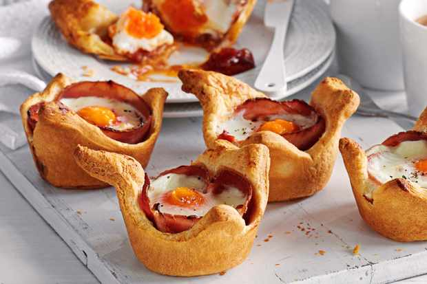 Eggs and ham baked in croissant cups