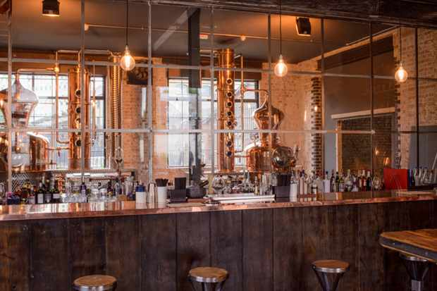 East London Liquor Company Bar with a copper still behind a glass wall
