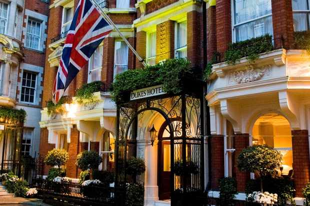 Dukes Hotel Mayfair red brick building with a British flag flying above the door