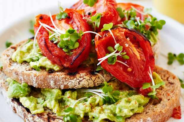 Roasted tomatoes and avocado on toast