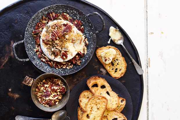Baked camembert with pecans, rosemary and olive oil toasts