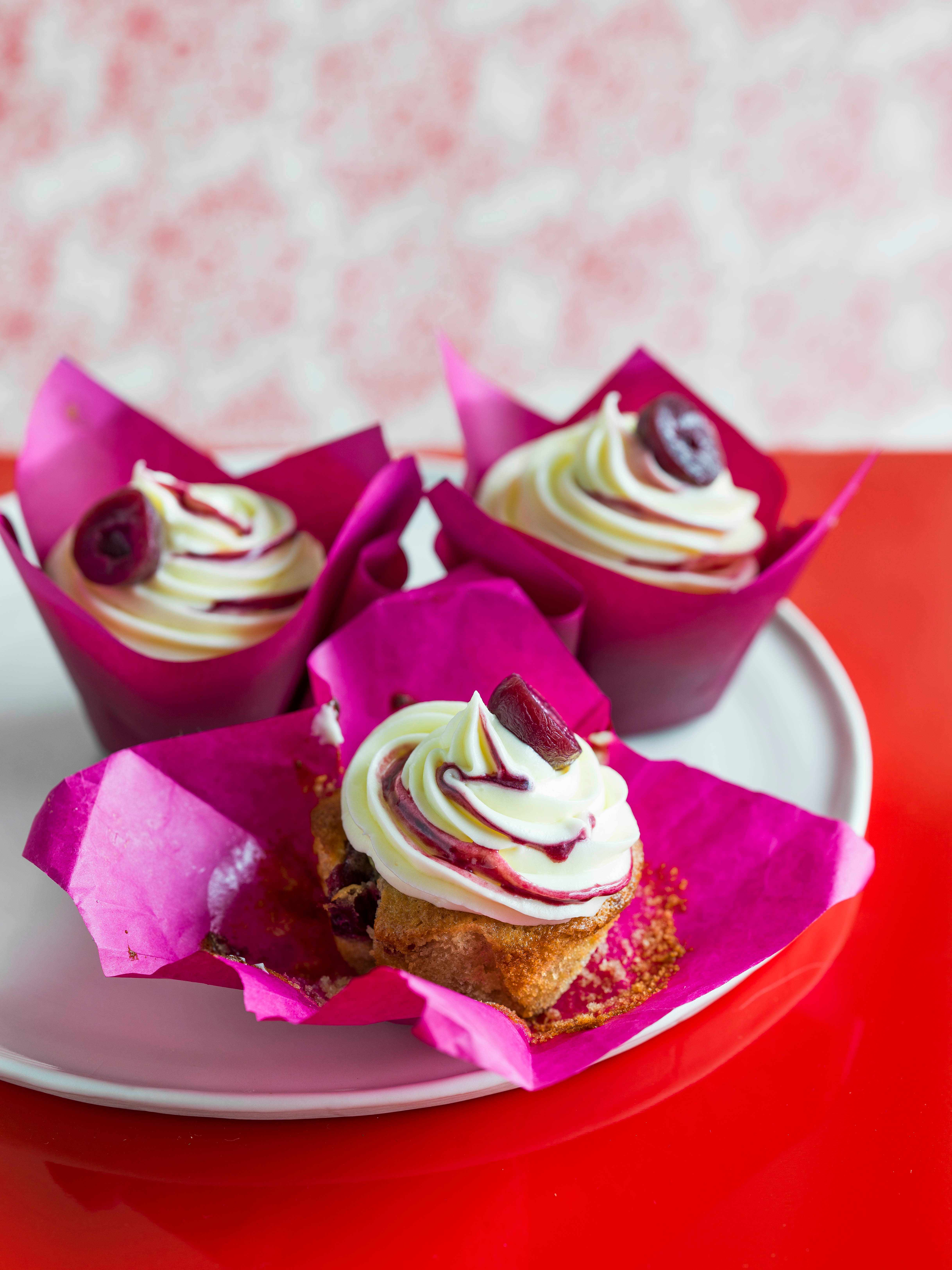 Sour cherry cakes with cream cheese frosting