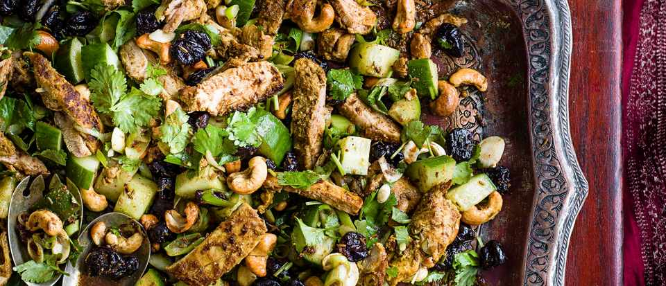 Marinated, spiced chicken salad with cashews and cucumber
