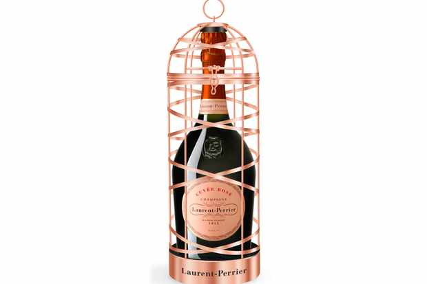 A bottle of Laurent-Perrier cuvee rose, housed in a rose gold birdcage for Christmas