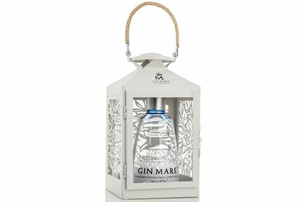 A white Mediterranean lantern, with a bottle of Gin Mare inside
