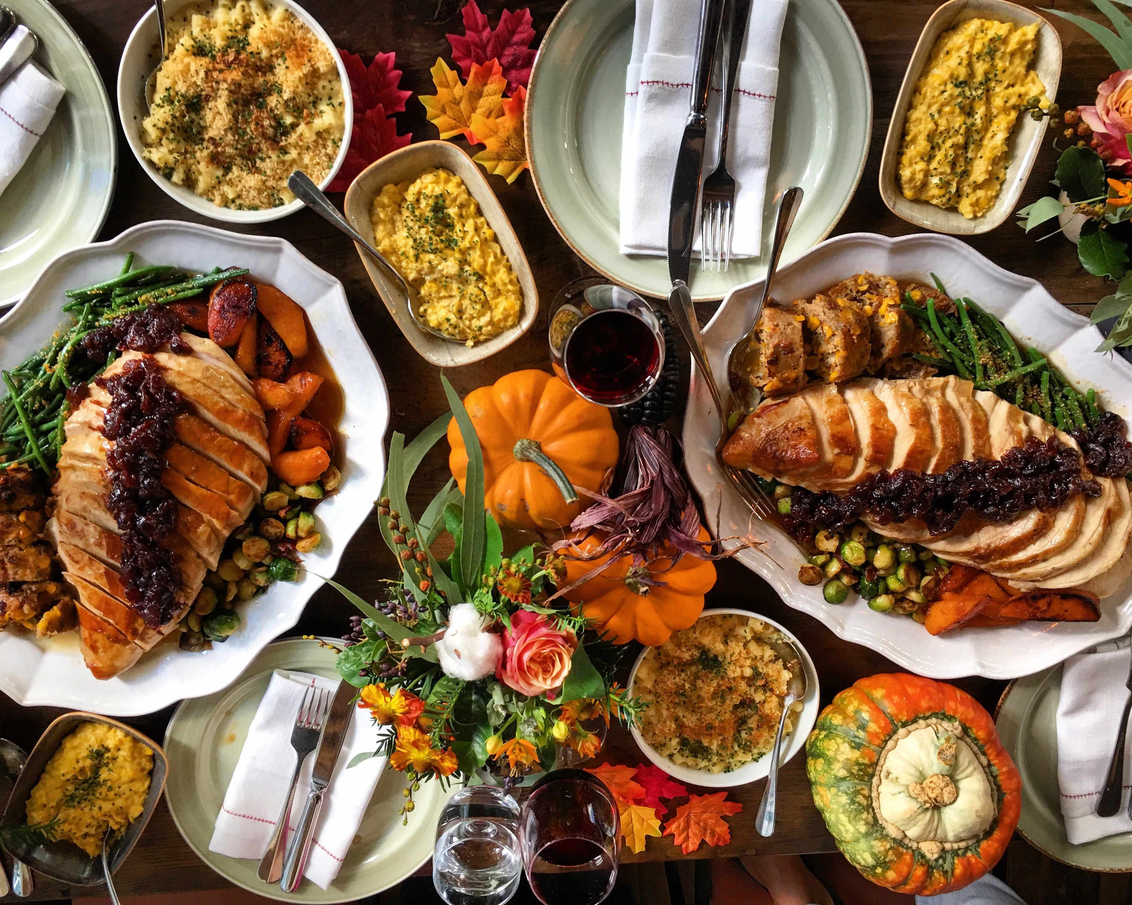 Thanksgiving feast at Rail House Cafe. On the table there is turkey, pumpkins, mac and cheese, stuffings