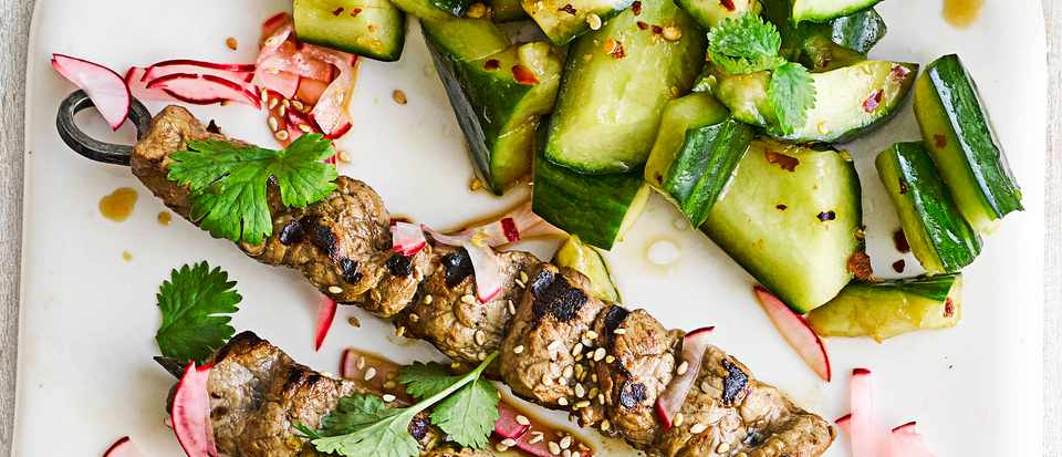 ribbon beef skewers with radish pickles and smashed cucumber