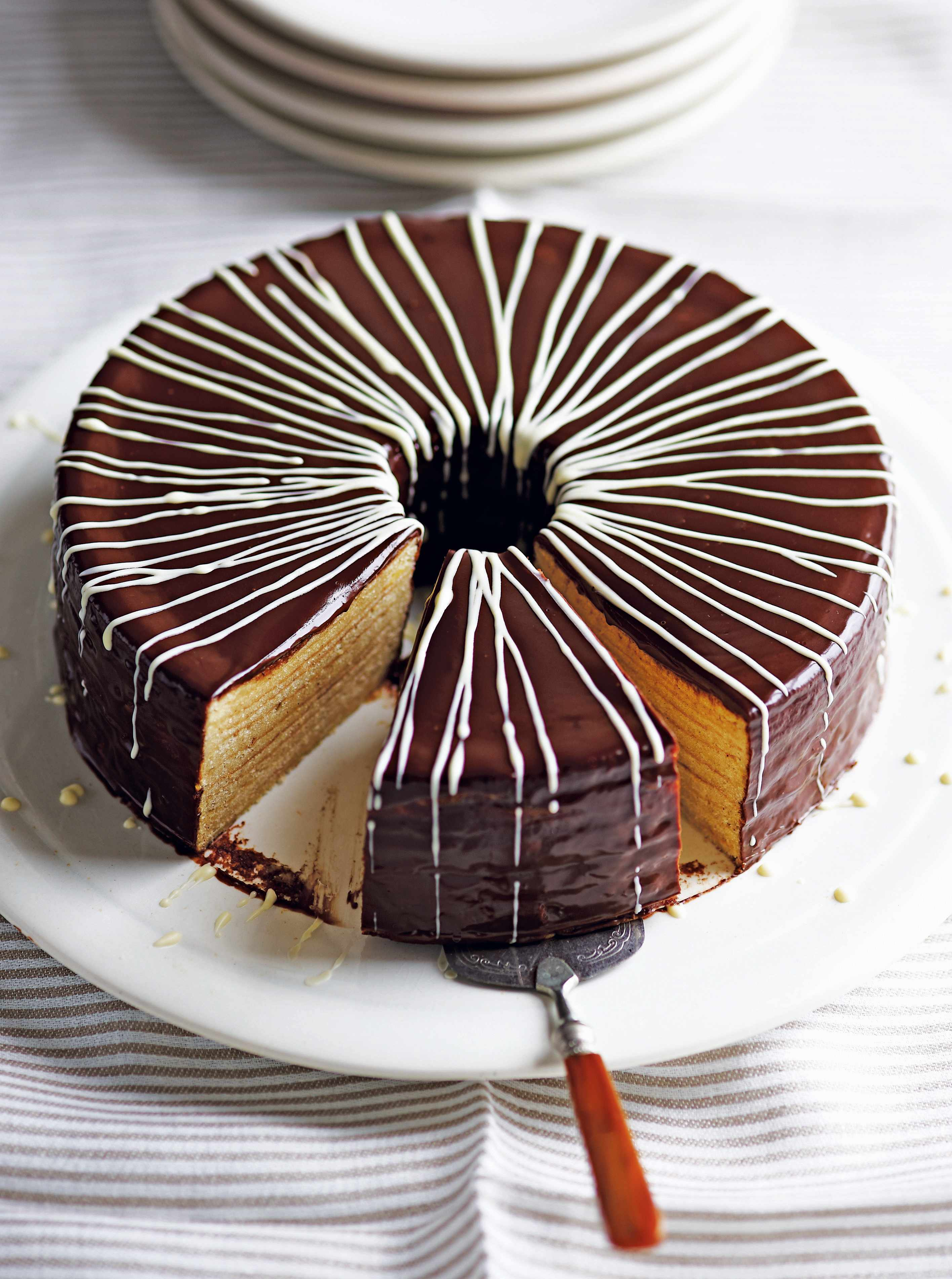 Spiced Rum Bamkuchen Cake Recipe - layered german christmas cake covered in chocolate glaze and white chocolate lines