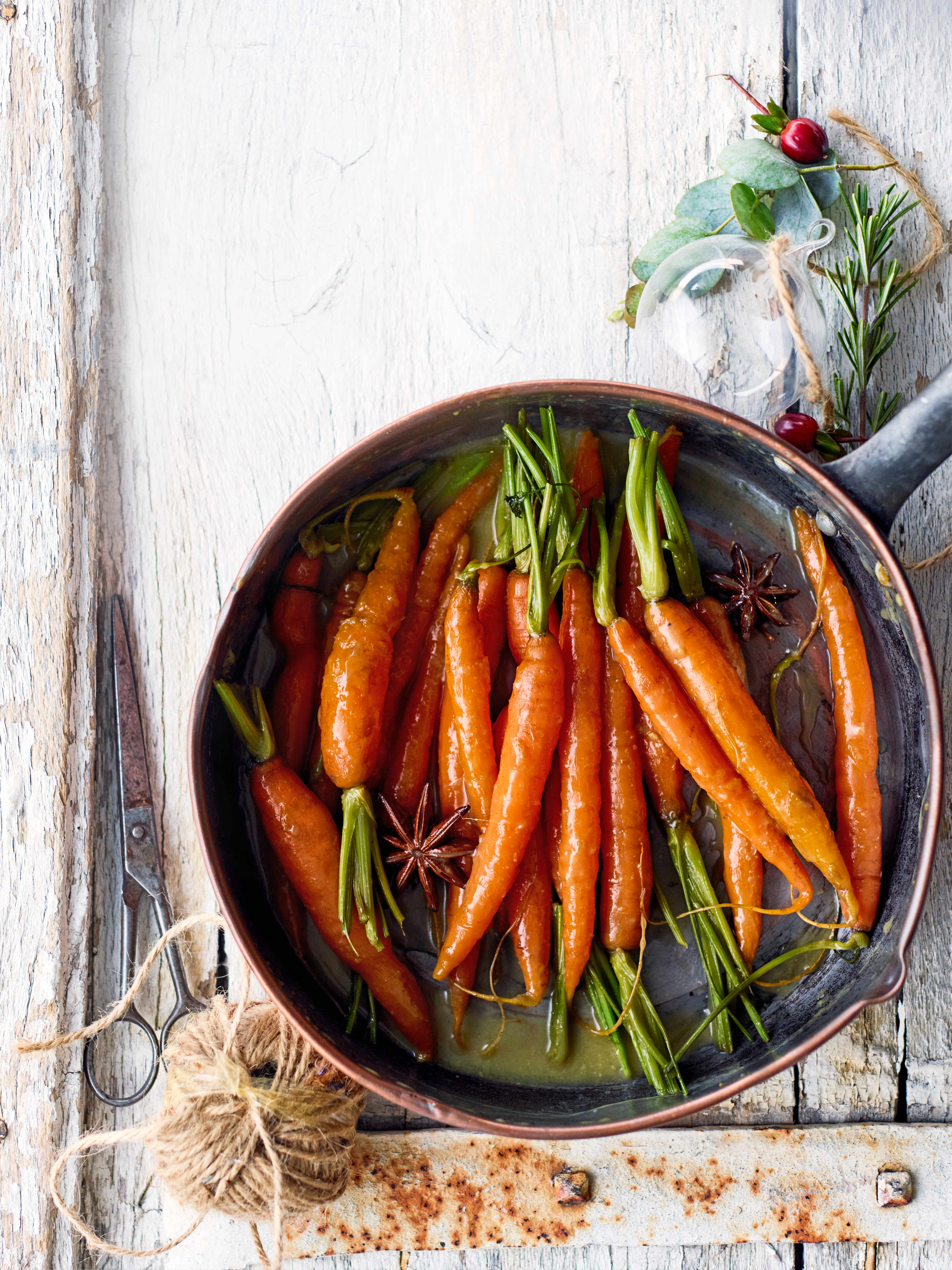 Star anise-glazed carrots in a pot