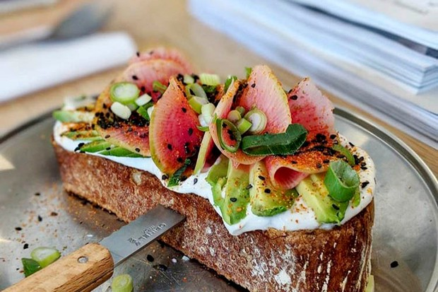 Thick slice of toast topped with avocado at Duikelman Amsterdam