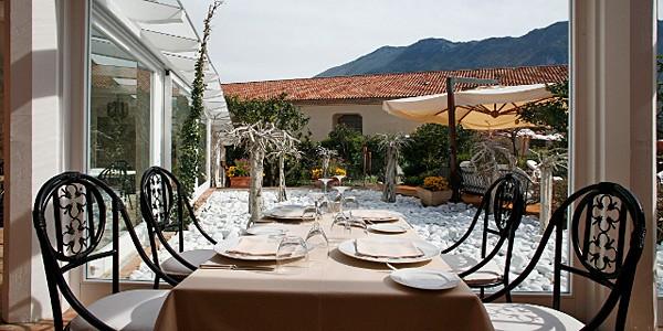 Tables and chairs on a terrace at La Locanda Delle Donne Monache, Basilicata