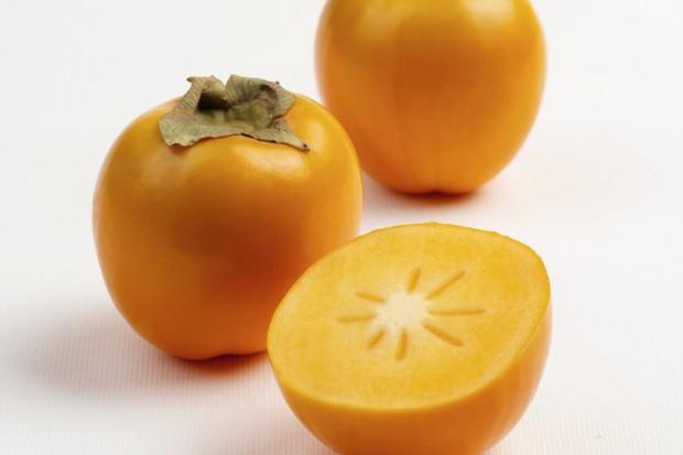 Three Spanish persimon fruits
