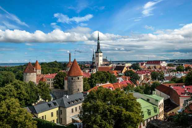 Tallinn overview of rooftops, a church spire and colourful buildings