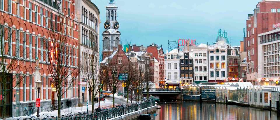 Best places to eat and drink in Amsterdam. Amsterdam's buildings and canal in winter