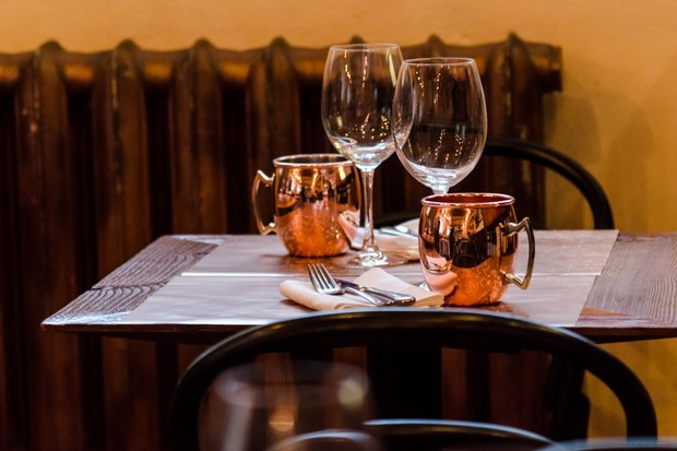 Wine glasses and copper goblets on a table