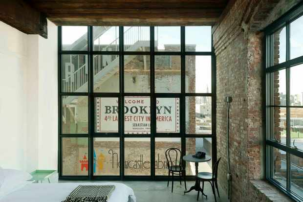 Large warehouse style windows the a Brooklyn sign outside