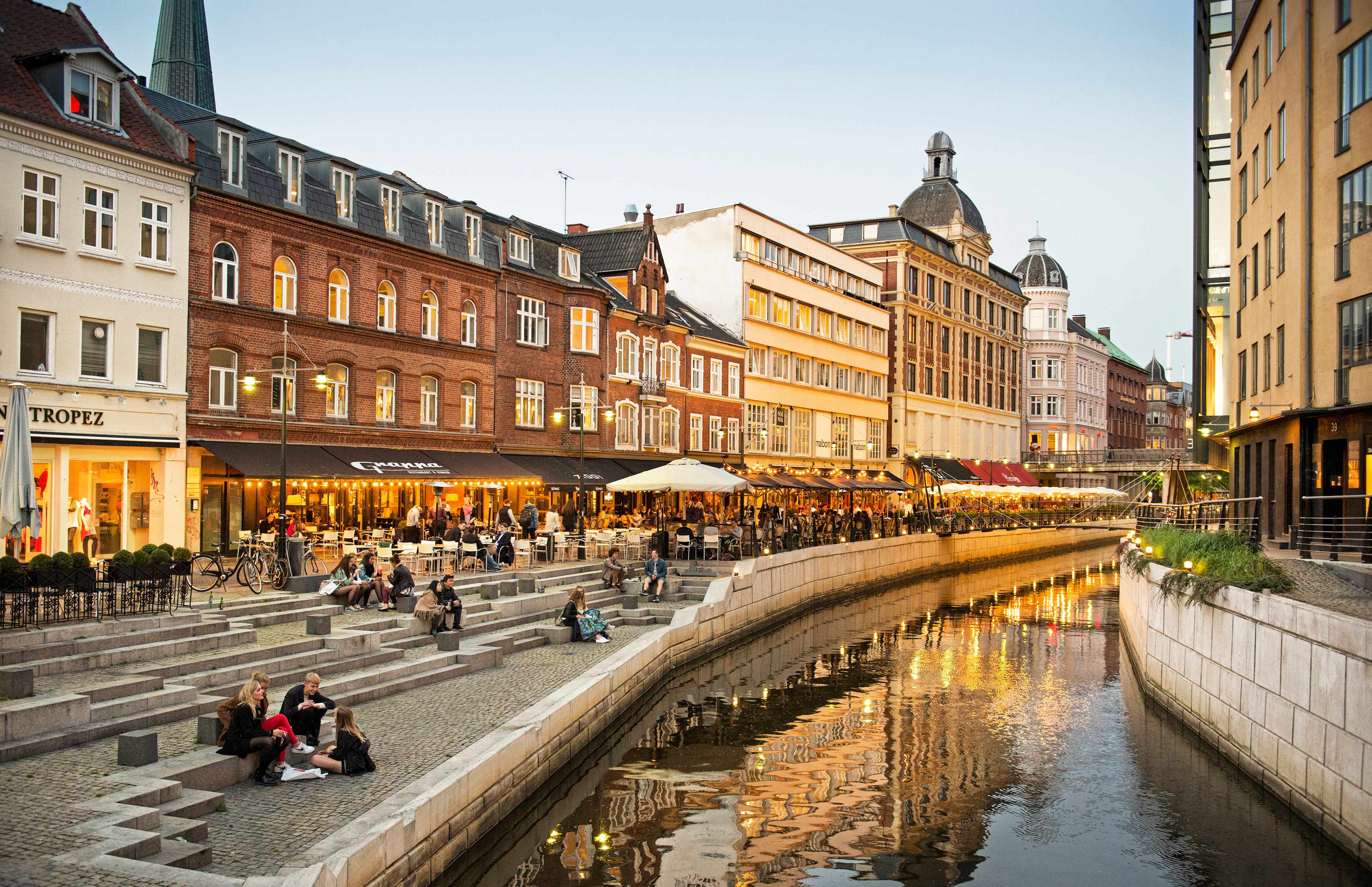 A canal and sunset-lit buildings in Aarhus Denmark
