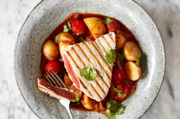 Chargrilled Tuna and Potato Stew with Harissa served in a grey bowl on a white marble surface