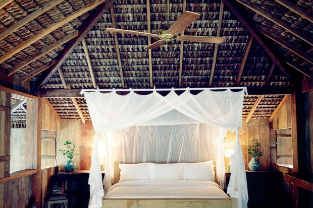 Room with large white flour poster bed at Uxua Casa Hotel and Spa, Trancoso, Brazil