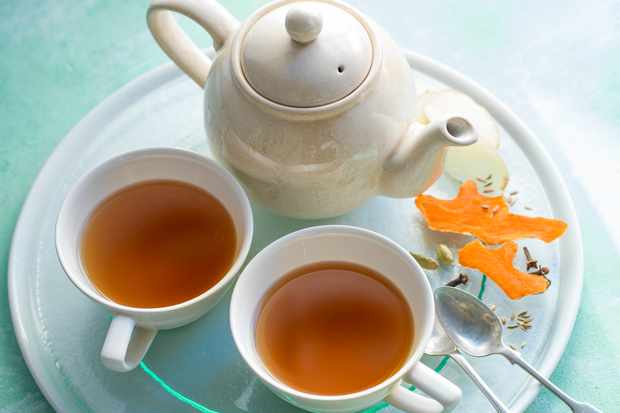 Turmeric CHai Tea in two cups with a tea pot